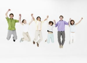 Group of Friends Jumping Together --- Image by © Royalty-Free/Corbis